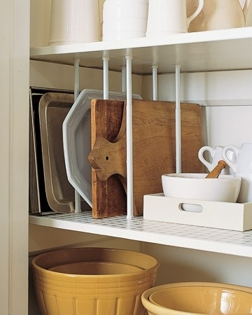 Use Tension Curtain Rods as a Divider for Cupboards