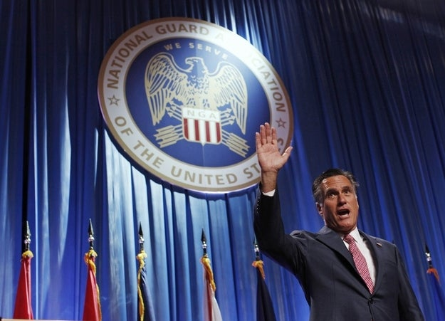 Romney waves after addressing the National Guard Association's convention in Reno, Nevada.