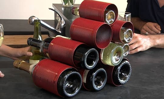 Remove both ends of the can, arrange, stack, and glue. Paint the cans beforehand if you want to add some color.