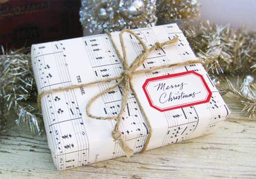 store bought wrapping paper is a social construct use something more fun like sheet music