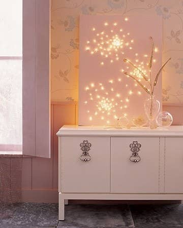 7  Create a lit up display by poking holes in a canvas. 46 Awesome String Light DIYs For Any Occasion