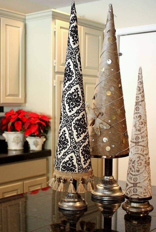 make trees wrapped in the fabric or wrapping paper of your choosing