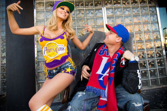 """L.A. couples dont always like the same team, and although that can complicate things its not necessarily a deal breaker for most. Chaz Bautzer and Lindsay Marie, creators of Beverly Hills' """"Pimps and Hos Clothing"""" make it work by finding inspiration in both teams by offering colorways to suit Lakers and Clippers fans alike. This cute couple is just as competitive as their teams. When asked about them Chaz responded I think the Clippers are the show. Its all about new blood. I bleed red, white, and blue. Lindsay Marie replies, You don't move to LA to become a Clippers fan. Its all about the dynasty, the Lake Show!"""