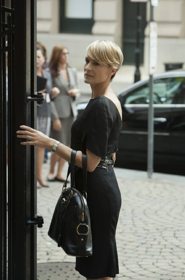 World's best haircut? Check. Form-fitting black dress? Check. YSL bag? Check. This woman is clearly a goddess who only deigns to walk among us mere mortals.