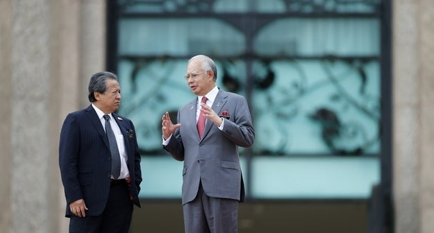 Malaysia's Prime Minister Najib Razak (R) talks to Foreign Minister Anifah Aman outside Razak's office in Putrajaya, near Kuala Lumpur on February 28.