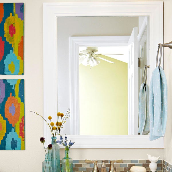 A happy bathroom combines design and functionality. Framing your mirror quickly updates the feel of your itty-bitty bathroom. Use molding and paint it whatever color you like best, or use basic trim if you're not into the traditional look. Step-by-step instructions here.
