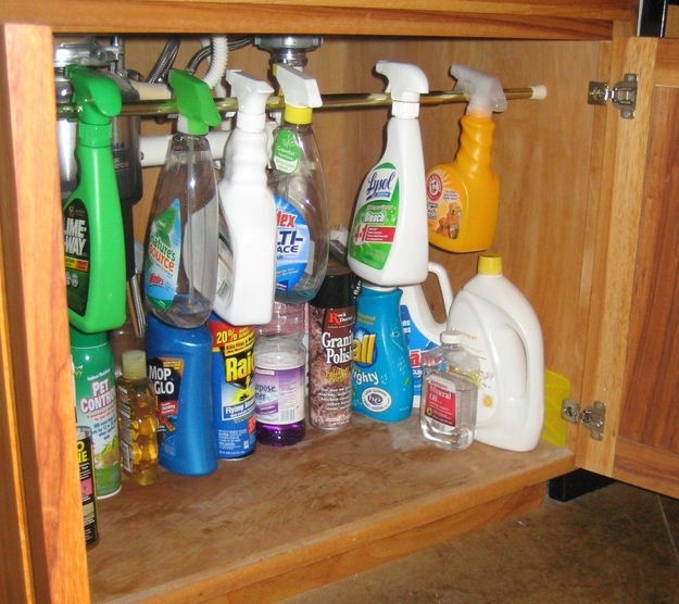 Keep your cleaning supplies neat with a tension rod.