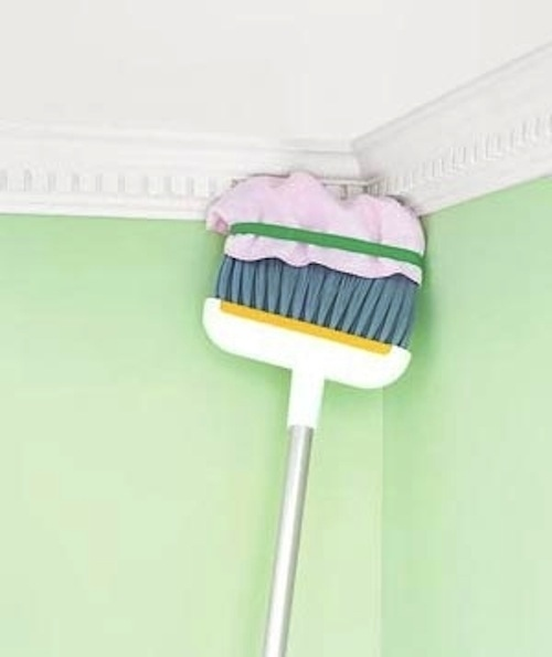 Towel + broom = a way to reach high, hard-to-clean spaces.
