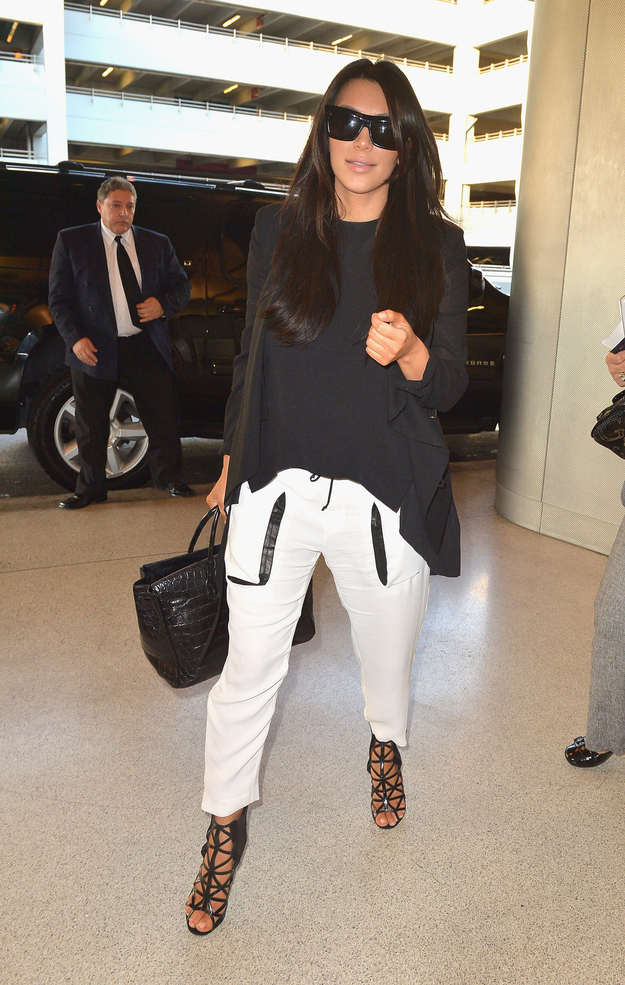 Indulge in loose, leather-trimmed pants at airports only.