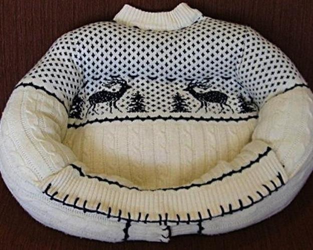 Stuff a sweater to make a cheap pet bed.