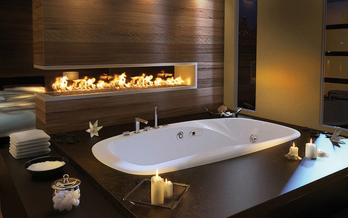 A Fireplace Next to the Bathtub