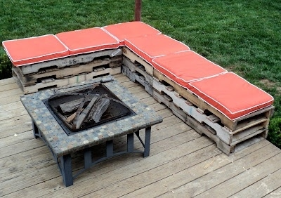 A wooden pallet sectional is easy to put together and provides lots of extra seating for outdoor parties.