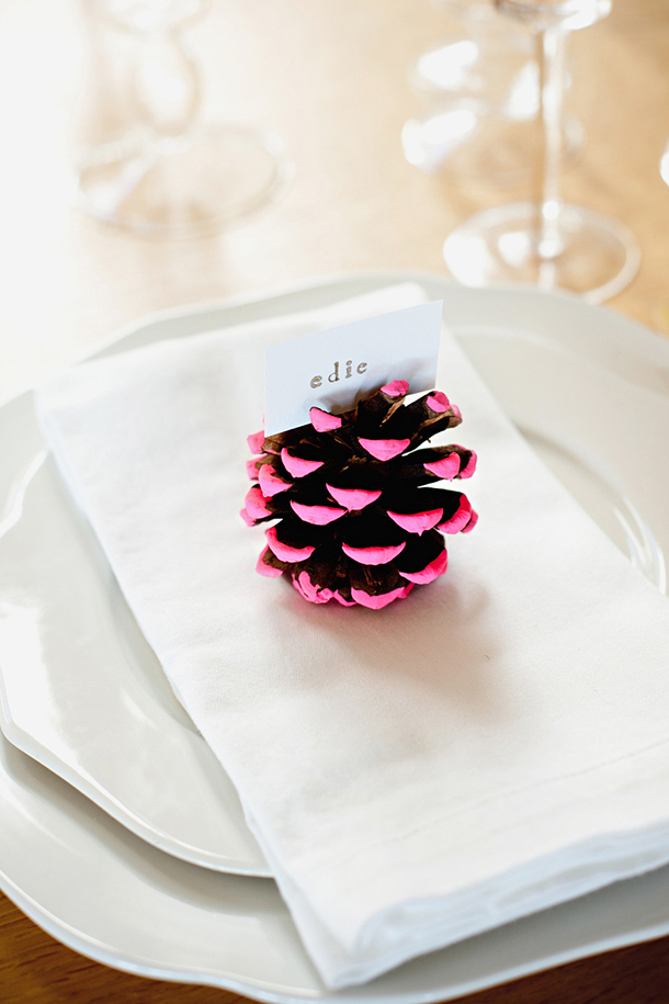 neondipped pine cone place card holder