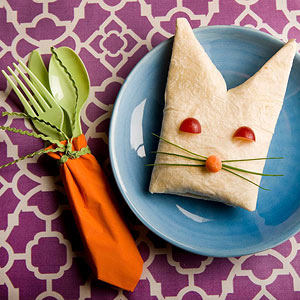Cut a triangle into one end of a burrito for a bunny-inspired lunch.