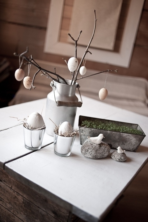 For a bare-bones, au naturale look, hang eggs off of bare branches.