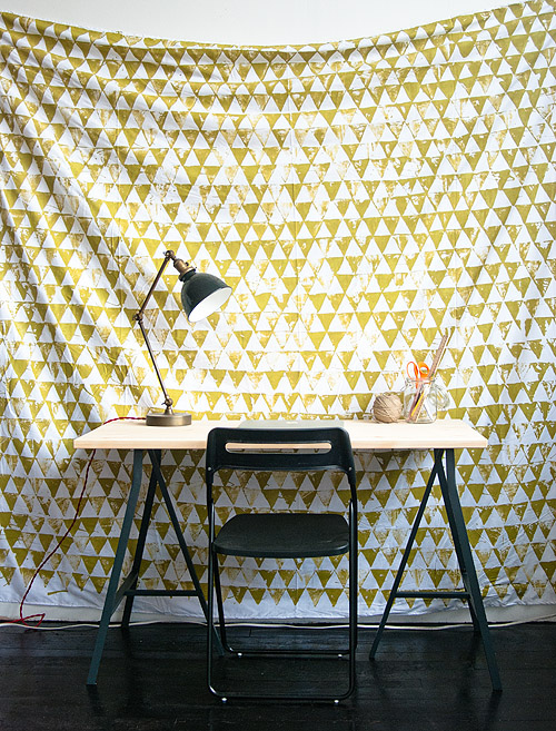 Or just give off a wallpaper effect, with this geometric wall hanging.