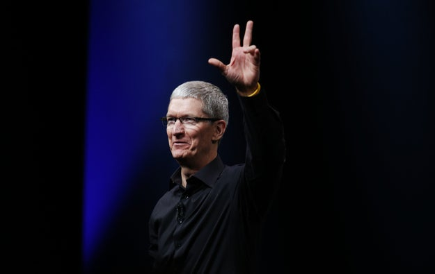 Apple CEO Tim Cook waves at the end of Apple Inc.'s iPhone media event in San Francisco, California September 12, 2012.