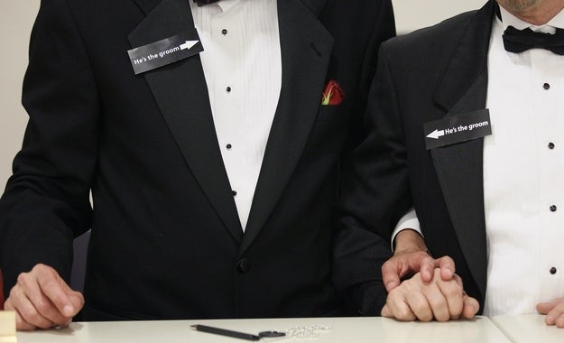A couple hold hands after getting a civil union in Colorado, May 2013.