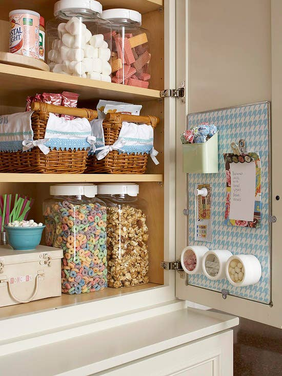 Even if you only have one or two little cabinets, you can still stick a corkboard or a magnetic board in there. From Better Homes and Gardens.