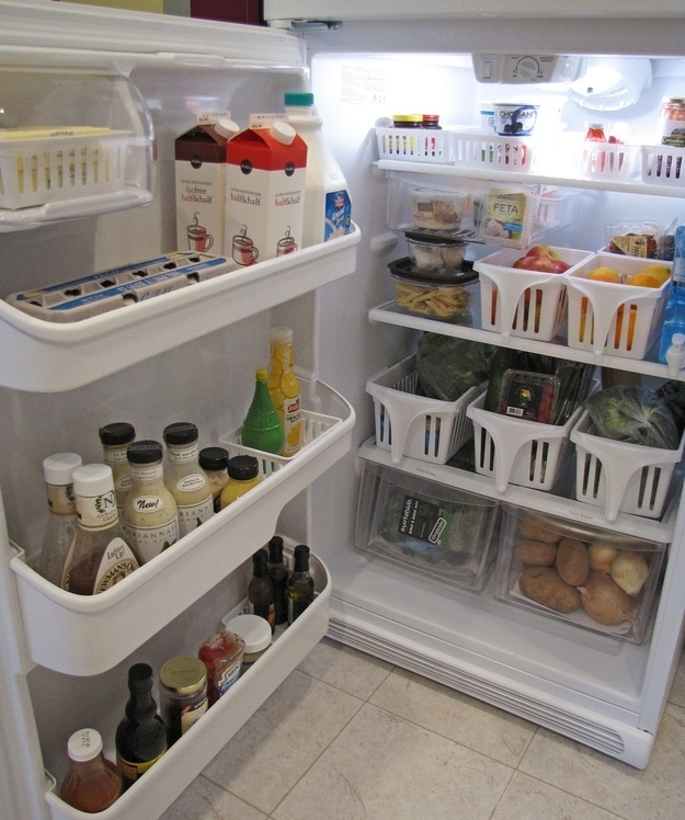 Keep things in place with baskets. & 27 Brilliant Hacks To Keep Your Fridge Clean And Organized