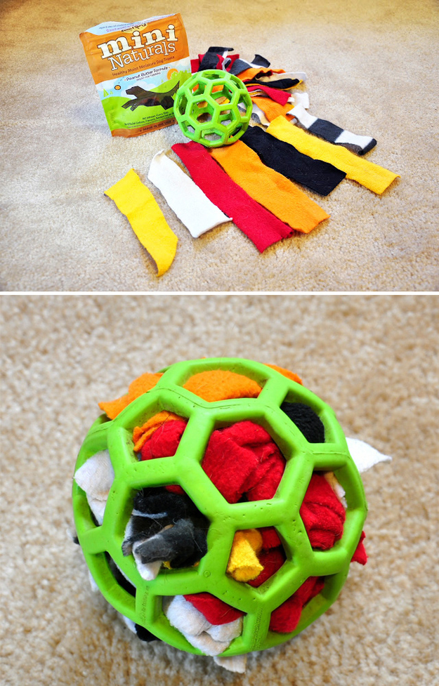 For a dog who loves to tear apart stuffed animals, make a durable activity ball with a Hol-ee rubber ball, scraps of fabric, and treats.