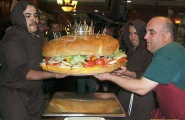 Where: Clinton Station Diner – Clinton, N.J.Challenge: At 105 pounds, The 8th Wonder is the largest burger in the world. It's 28 inches in diameter and 11.5 inches tall. Ten people are given only 60 minutes to demolish this beast (that's 10.5 pounds of food per person).Prize: A cash prize of $5,000 is given to all successful teams, but the odds are stacked against them; no one has ever conquered this challenge.