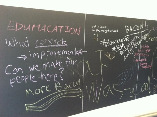 """A blackboard in Twitter's cafeteria where Twitter employees are asked to share ideas on how the company can """"better serve the community."""""""