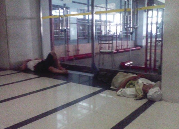 Workers sleep outside Pegatron's gates.