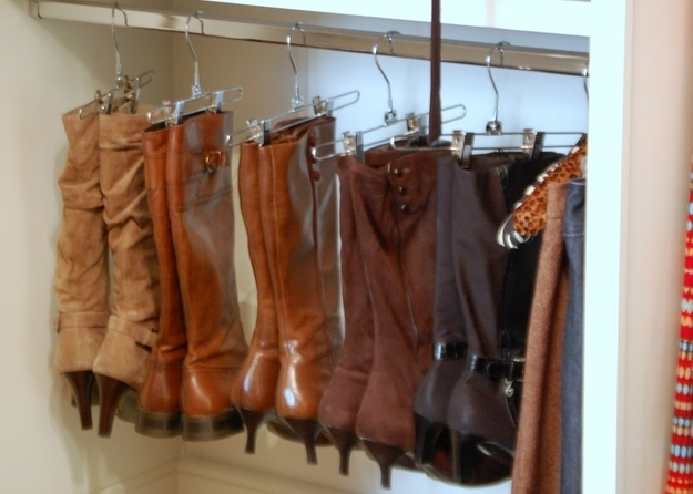 Use clothing hangers to organize your boots.