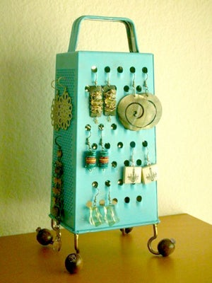 If you can afford to spray-paint a cheese grater in a vibrant shade of turquoise and own enough earrings to hang on it, I assure you that you can afford something else, ANYTHING ELSE, for organizing.