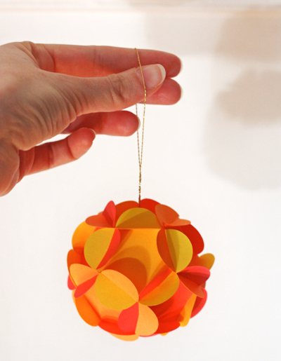 Fold paper to make this origami-inspired ornament.
