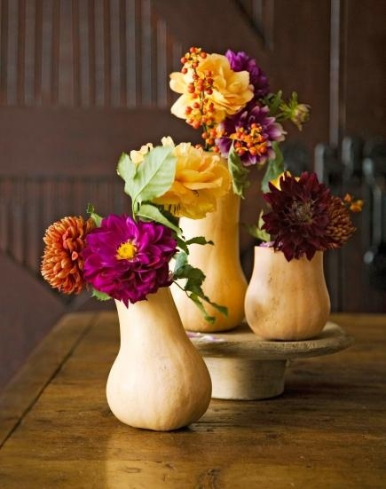 Those are ACTUAL GOURDS being used as vases: