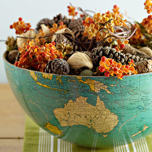 Cut an old globe in half and fill it with fall foliage: