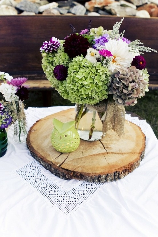Use a thin slab of wood to instantly make a vase of flowers look more special:
