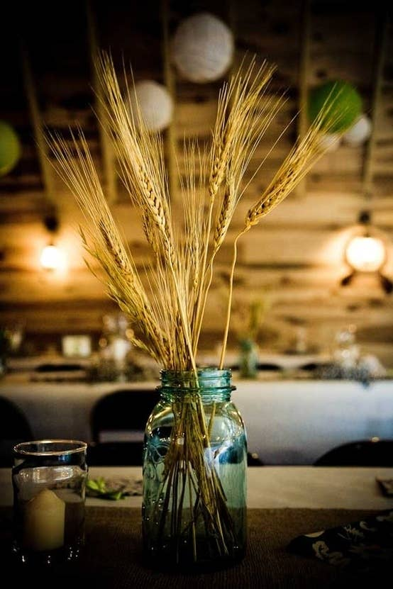 They're available at farmer's markets and in craft stores; the advantage to using these, besides the fact that they are pretty and smell great, is that your sightlines will be much more clear and you can see all of your guests' smiling faces. This is something to consider with all centerpieces.