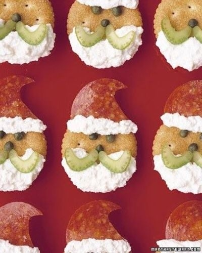 The Santa hats are made from pepperonis while the fluffy white stuff is ricotta cheese. Top with celery and capers.