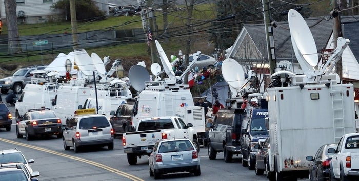 Media vans and trucks in Newtown, Conn., Wednesday, Dec. 14th.