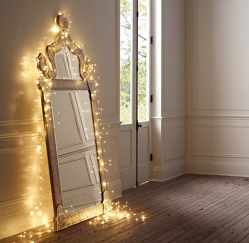 Frame your mirrors with starry string lights.
