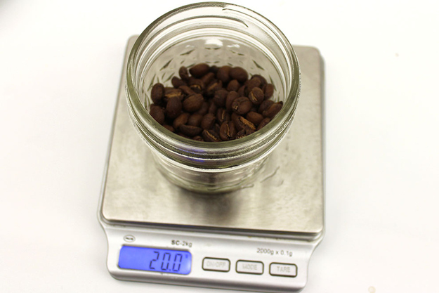 Measure out 2 grams of beans for every ounce of water