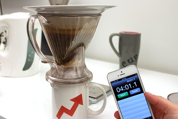 At the end of the four minutes, take the dripper off of the scale and set it on top of the coffee cup.