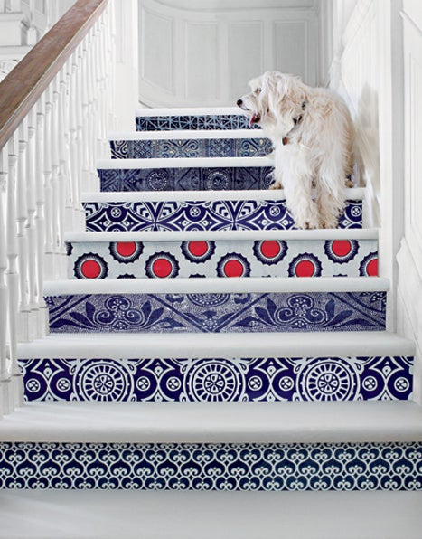 Paste wallpaper to the riser of each stair-- switching up patterns makes it extra eye-catching, as in this pic.