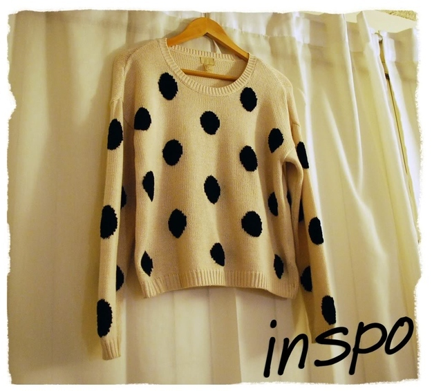 Polka dot a sweater with a felting needle.
