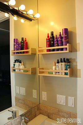 Two Bekvam spice racks fit all of that stuff you use every day (or think you'll use every day). Add a coat of paint or stain if you want to color-coordinate them with the rest of your bathroom. You could also hang them on the inside of your cabinets so they're out of sight. Originally here.