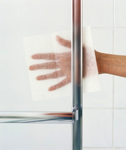 Dryer sheets will remove buildup from glass.