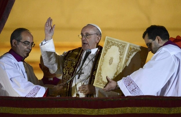 Newly elected Pope Francis, Cardinal Jorge Mario Bergoglio of Argentina, appears on the balcony of St. Peter's Basilica after being elected by the conclave of cardinals, at the Vatican, March 13, 2013.
