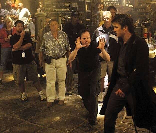 Whedon (center) directing Nathan Fillion (right) on the set of Serenity.