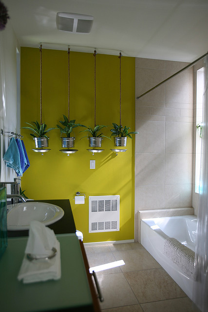 Plants In A Sunlit Bathroom Add Tons Of Character.