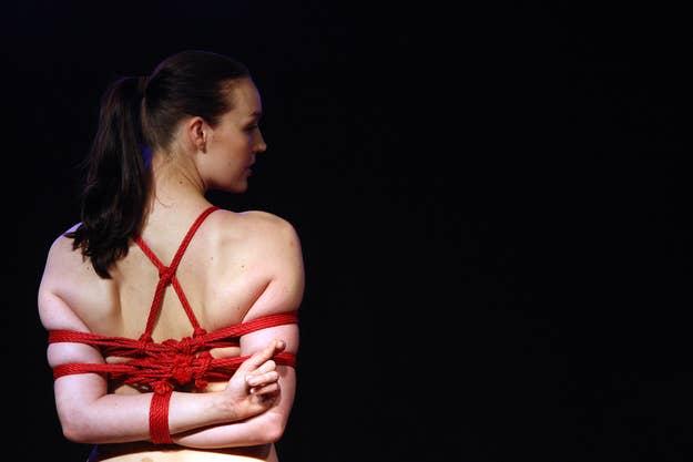 A model poses during a bondage demonstration at the 2012 Venus Erotic Fair in Berlin.