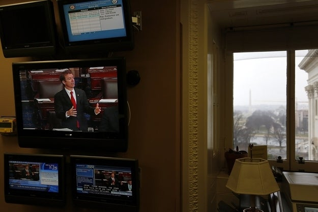Rand Paul appears on a television screen in an office at the U.S. Capitol as he filibusters on the Senate floor.