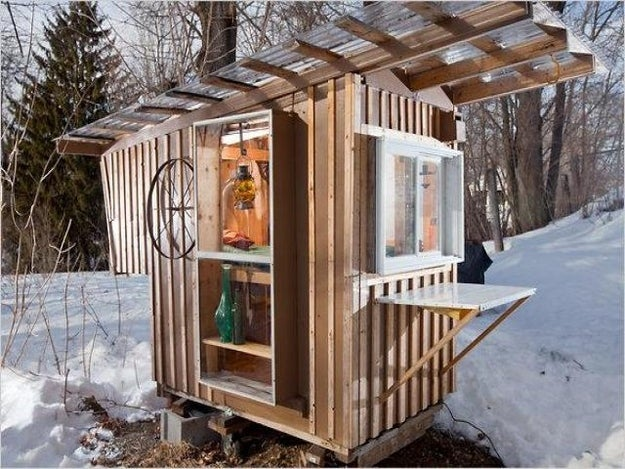 """The house and its builder, micro-architecture enthusiast Derek Diedricksen, were featured in The New York Times; it's called the """"Gypsy Junker"""" and is """"made primarily out of shipping pallets, castoff storm windows and a neighbor's discarded kitchen cabinets."""" It's a steal at $1200."""